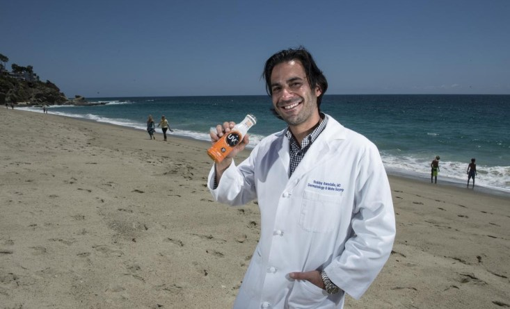 Bobby Awadalla, MD, founder & CEO of UVO sun protective drink, shows his product at Laguna Beach.       //ADDITIONAL INFORMATION: sunscreen.0612 Ð 06/05/15 Ð ED CRISOSTOMO, ORANGE COUNTY REGISTER  Dr. Bob Awalla, a noted skincancer surgeon, has patented a drinkable sunscreen.