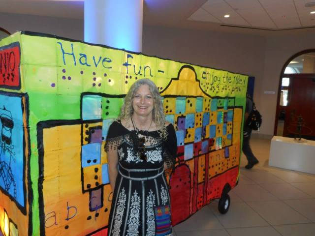 Maureen 'Momo' Brown waits for a ride on the 'San Antonio Bus' she created with Charles 'Pompa' Harrison.