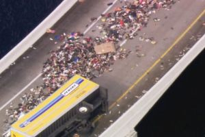 miami-truck-overturns-thousands-of-sneakers_a9nhoa