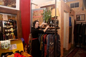 Employee Hannah Taube arranges merchandise at Gypsy Chic.