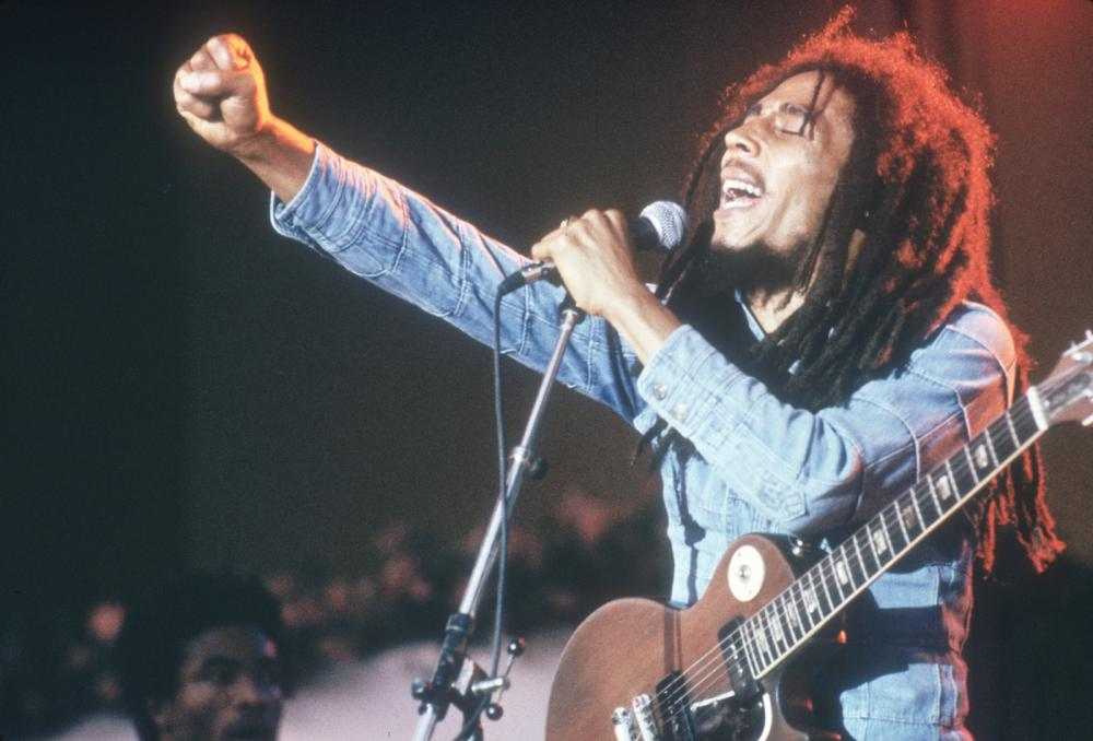 Jamaican Reggae musician, songwriter, and singer Bob Marley performs on stage