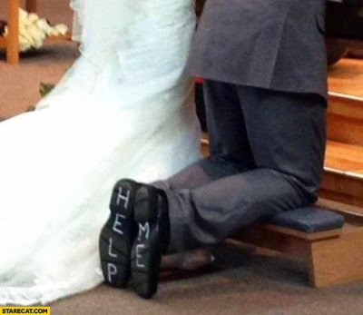 Wedding help me written on bottom of the shoes | StareCat.com