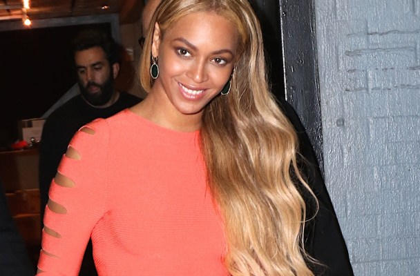 Beyonce was cheerful in spring colors this evening as she was seen leaving with her husband Jay Z from their studio in NYC