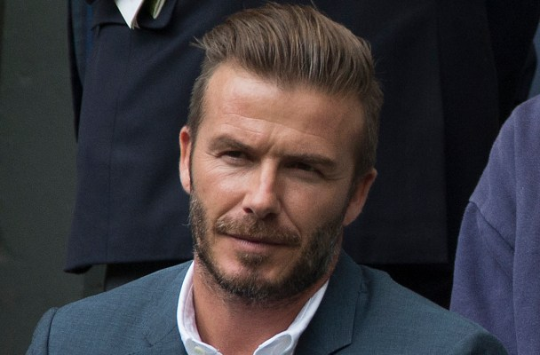 Romeo Beckham attend day nine of the Wimbledon Lawn Tennis Championships at the All England Lawn Tennis and Croquet Club on July 8, 2015 in London, England  Pictured: David Beckham Ref: SPL1073996  080715   Picture by: Splash News  Splash News and Pictures Los Angeles:	310-821-2666 New York:	212-619-2666 London:	870-934-2666 photodesk@splashnews.com