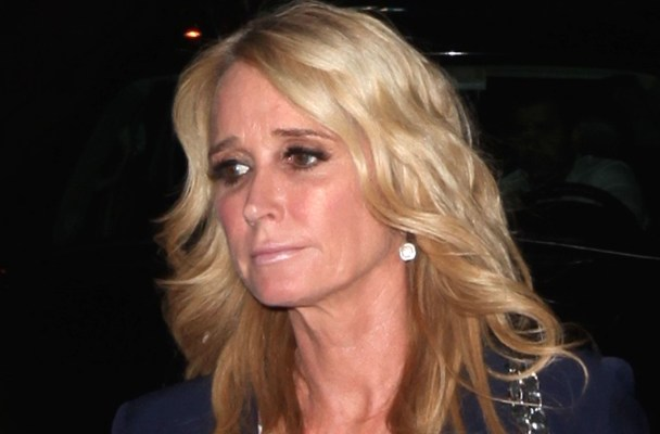 West Hollywood, CA - Kim Richards carries presents as she arrives at Kathy Hilton's belated birthday dinner party held at Craig's Restaurant.  The RHOBH star dressed casual in a blue blazer over a white blouse, jeans and a pair of nude high h