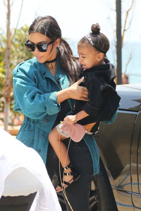 monster mom kim kardashian admits spraytanning north