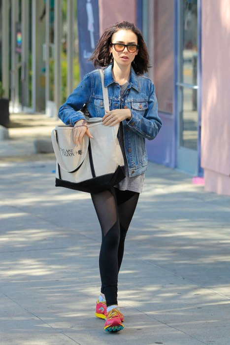 *EXCLUSIVE* Lily Collins covers up with denim after a workout