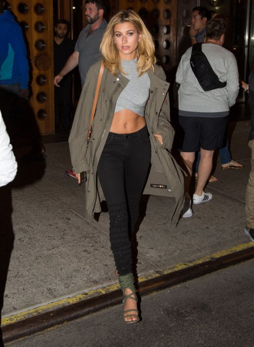 Hailey Baldwin smiles walking through windy Soho block leaving party for Ugg boots in NYC.