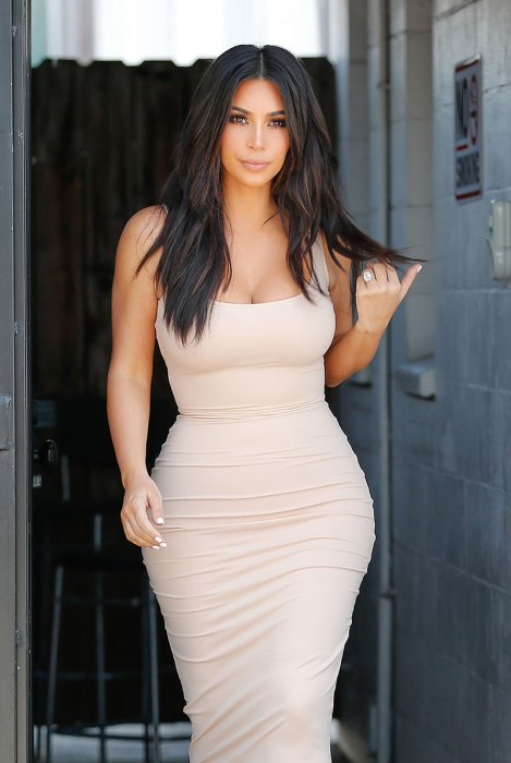 Kim Kardashian shows her 26 inch waist leaving the studio
