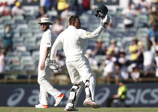Australia's Usman Khawaja ackowledges the crowd after scoring a Test century. (AP)