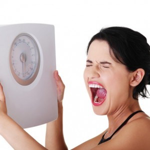 Woman who is frustrated holding scale