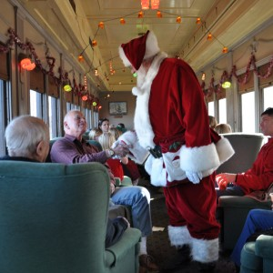 Santa Claus greets passengers aboard the Essex Steam Train in Connecticut