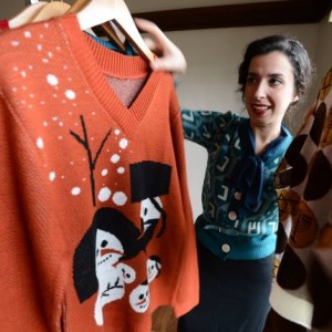 Carin Agiman looks through a selection of Hanukkah sweaters at their home in Berkeley, California, November 29, 2012. (TNS photo)