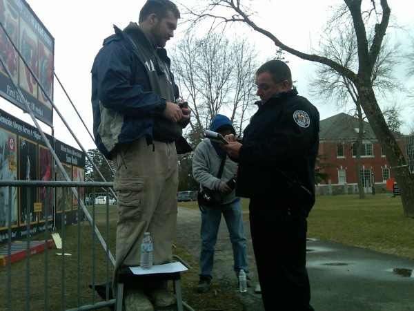 University of Maine Police Department Sgt. Robert Norman talks with Darius Hardwick, the midwest regional director for the Center for Bio-Ethical Reform and a member of the Genocide Awareness Project, after a harassment complaint was filed with the police regarding Monday's demonstration.