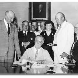 Franklin D. Roosevelt signs the Social Security Act, August 14, 1935