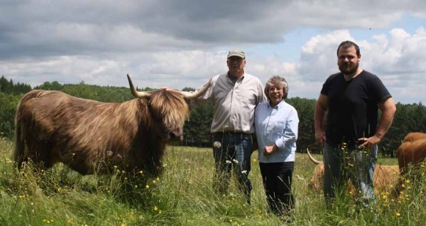 Stan and Gail Maynard (from left), who grow organic highland cattle at Orchard Hill Farm in Woodland, and Troy Haines know that Aroostook County holds potential for raising cattle, pigs, sheep and goats. What this say is missing is a locally run USDA-inspected meat processing facility to maintain profitability for local farmers.