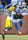 Former University of Maine star Jerron McMillian of Green Bay tries to break up a pass reception by Detroit's Calvin Johnson during Sunday's game in Detroit. McMillian is among several young players making an impact for the Packers.