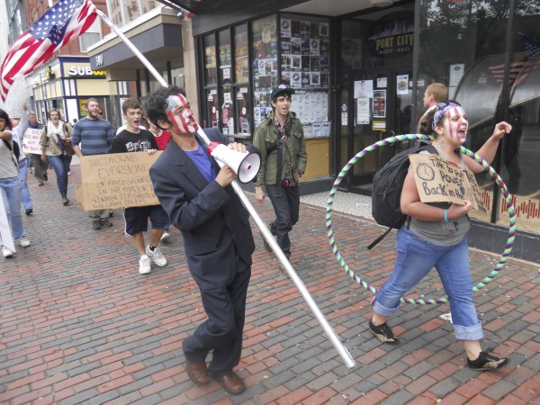 Travis Bonpietro, 24, of Gorham, and Rose Buckmore, 21, of Portland, lead a crowd of more than 60 people marching from Monument Square in Portland to University of Southern Maine in Oct. 2011. Th