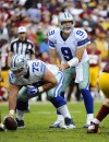 Dallas Cowboys quarterback Tony Romo (right), pictured in a Dec. 22 game against Washington, has undergone back surgery and will miss the rest of the season.