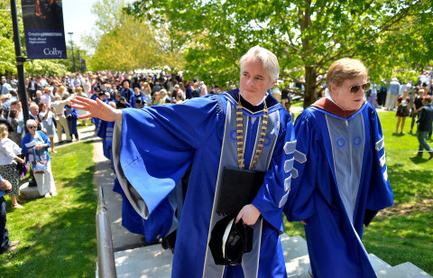 Colby College President David Greene (left) and actor/filmmaker Robert Redford march out with the graduating seniors at the school's commencement on Sunday, May, 24, 2015.