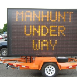 The Maine Department of Transportation put up highway message boards aimed at warning vacationers of the manhunt for Robert Burton, 38, of Parkman, who is accused of killing his ex-girlfriend, on Wednesday in Newport, Athens, Charleston, Milo and Monson.