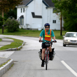 Lisa Scofield of Hampden rides up Rt. 1A in Winterport on June 6, 2015, on a 50-mile training ride. Scofield began a long ride through Maine June 19 to raise money for scholarships for women without insurance to be able to afford Wellspring residential services, a program for women with addiction.