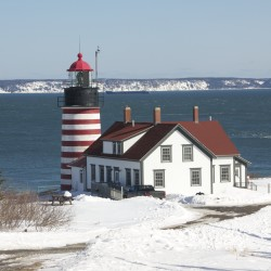 Drifting snow is seen along South Lubec Road, leading to the West Quoddy lighthouse, in this file photo.