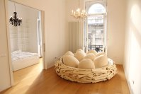 Giant Birdnest: Wooden Bed Filled With Soft Egg-Shaped ...