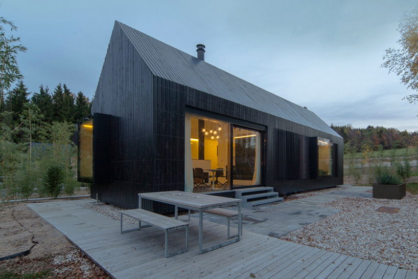 Hofgut Hafnerleiten Format Elf Nestles Dark Barn-shaped Houses Into Bavarian