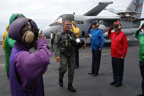 George W Bush on the deck of the USS Abraham Lincoln
