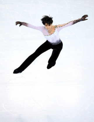 Yuzuru Hanyu of Japan wins gold at the men's free figure skating on day seven of the Sochi 2014 Winter Olympics.