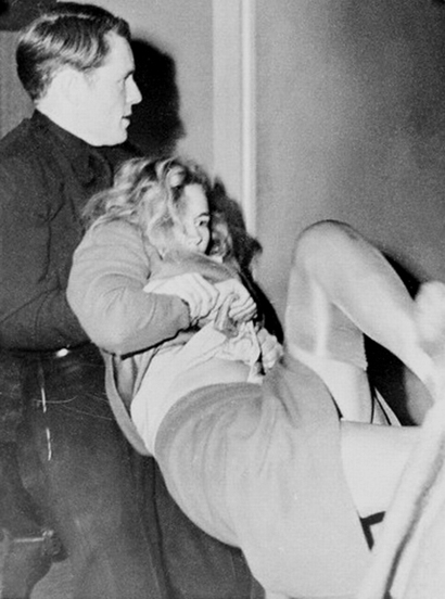 15 Jan 1943, Los Angeles, California, USA --- Actress Frances Farmer battles officers seeking to take her to jail cell after her arrest as a parole violator. Officer T.W. MacDonald is shown with the struggling actress. --- Image by © Bettmann/CORBIS