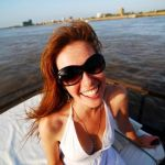 Michelle, cruising the Tonle Sap. Photo by the indomitable Lauren Crothers.