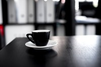Black and White Ceramic Tea Cup With Saucer on Black ...