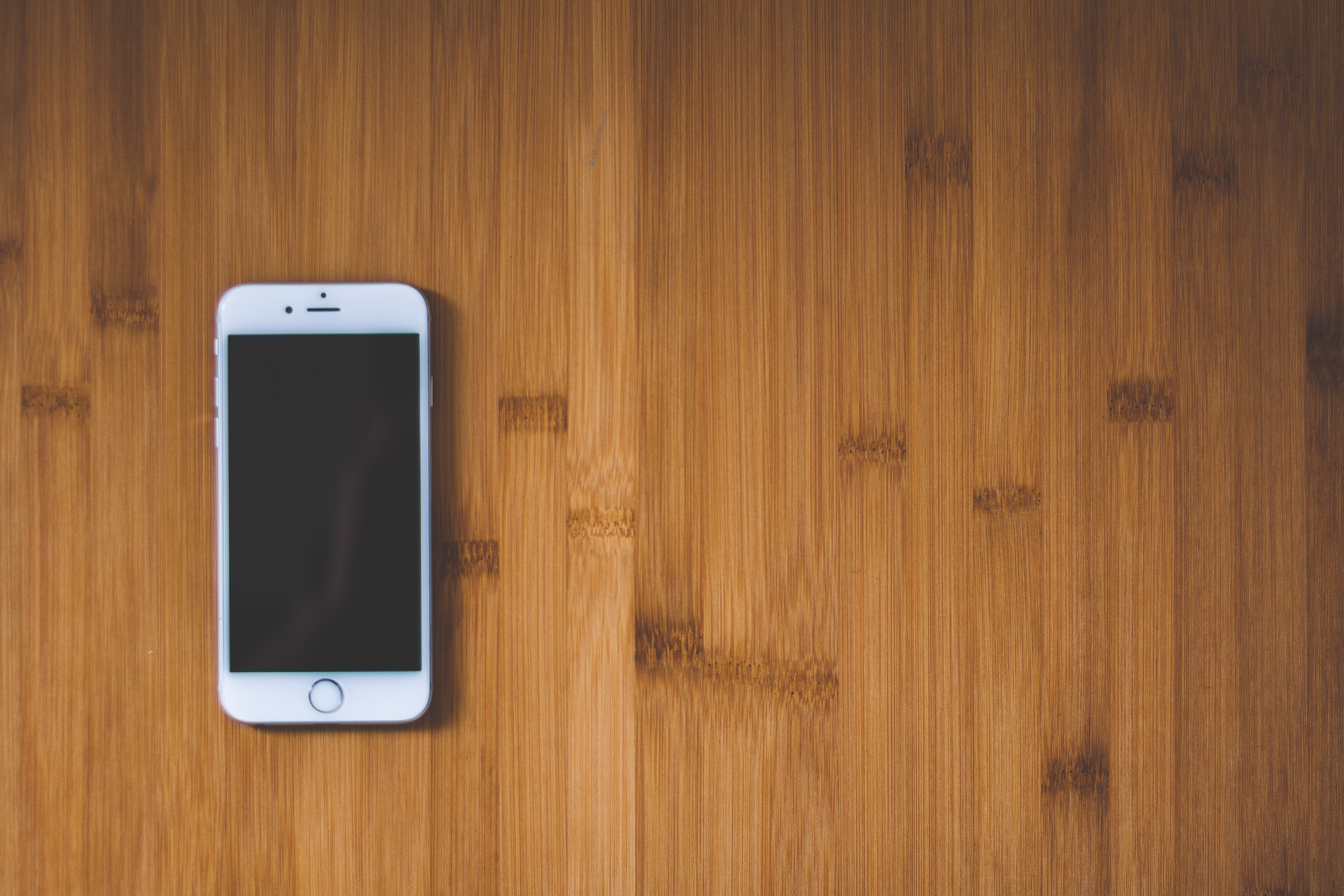 Apple Wallpaper Iphone 7 Silver Iphone 6 On Brown Wooden Surface 183 Free Stock Photo