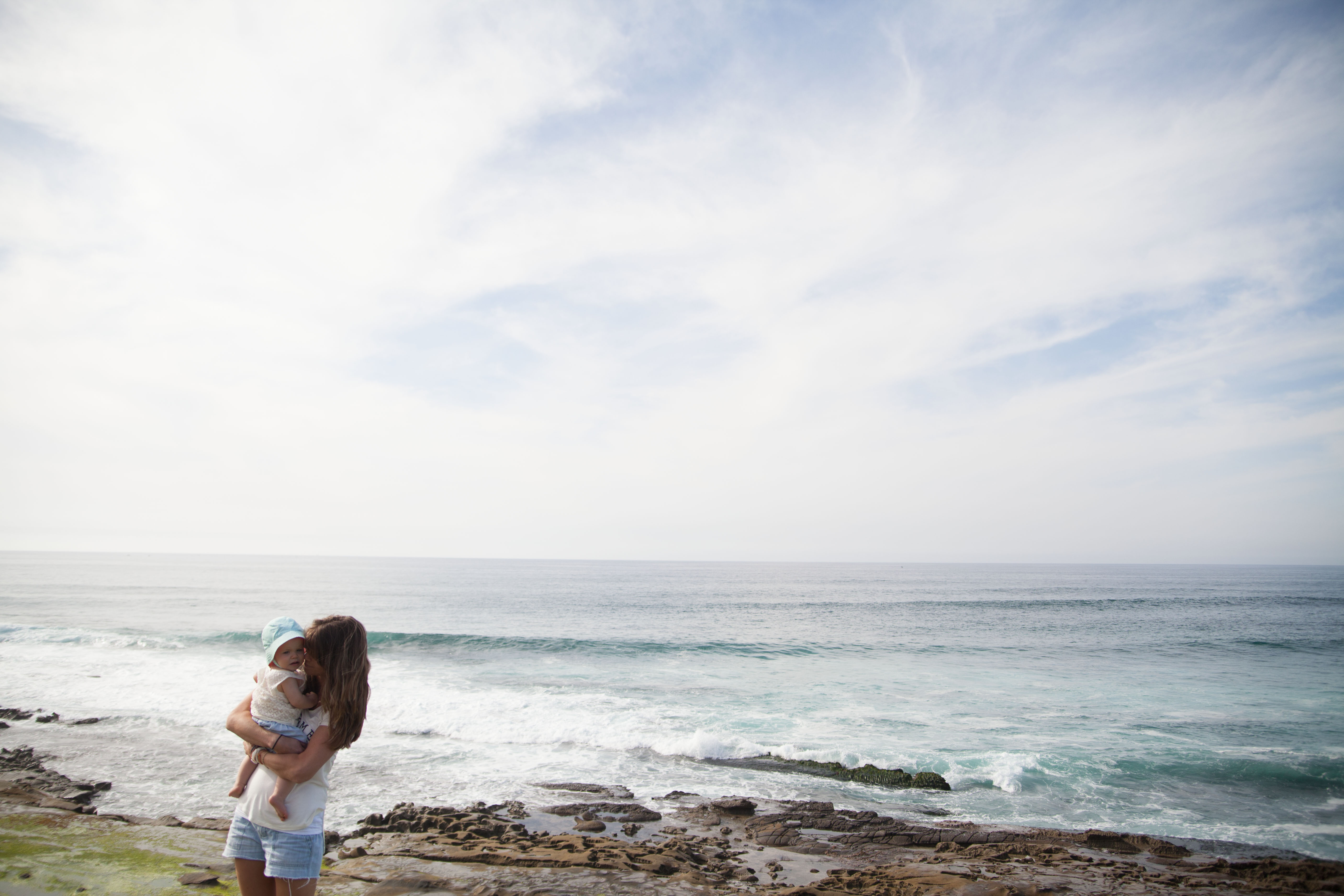 Beautiful Girl Wallpaper Pictures Download Mother Holding Her Baby In Front Of Seashore During