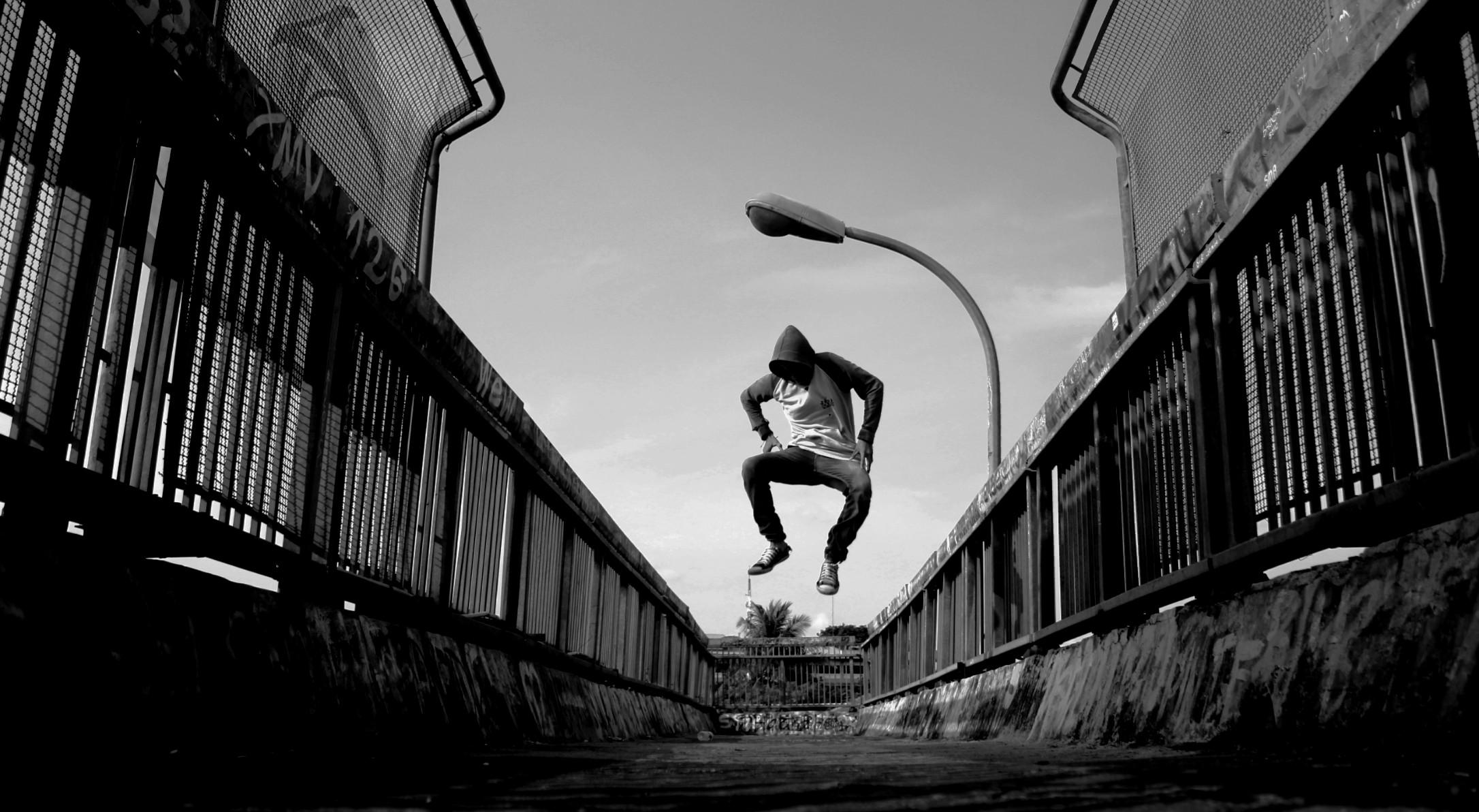Black Cat Wallpaper Man Jumping On Air Wearing Gray Hoodie 183 Free Stock Photo