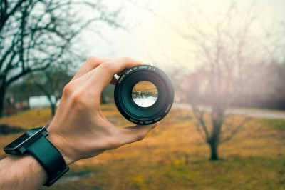 Photography of Person Holding Black Camera Lens · Free ...