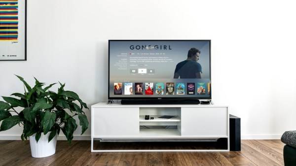 Black Flat Screen TV on White Wooden TV Rack in Living Room