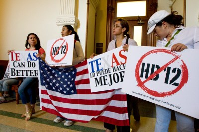 "Protesters block a rear entrance to Texas Governor Rick Perry's office on the second floor protesting HB12 the so-called ""sanctuary cities"" bill winding its way through the Senate on May 25, 2011."