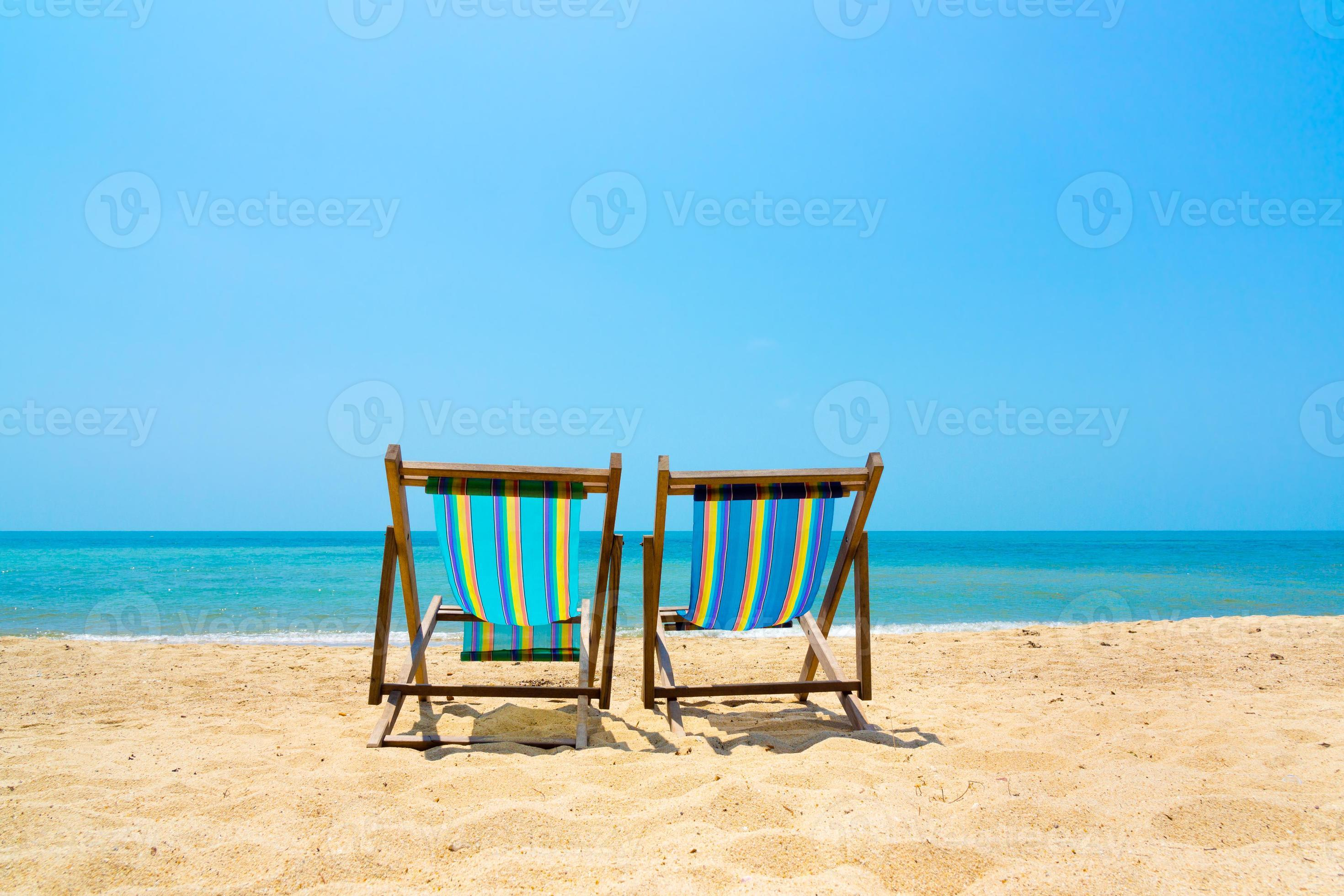 Two Lounge Chairs On The Beach 902343 Stock Photo At Vecteezy