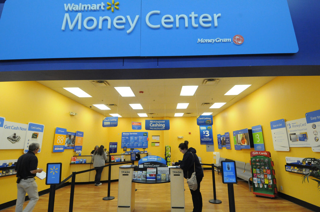 Wal-Mart Benefits From Anger Over Banking Fees - The New York Times