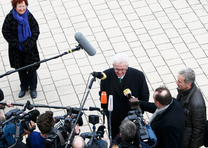 Winfried Kretschmann, the incumbent governor of the German state of Baden-Württemberg, spoke to the media outside a polling station in Sigmaringen on Sunday. Credit Michaela Rehle/Reuters
