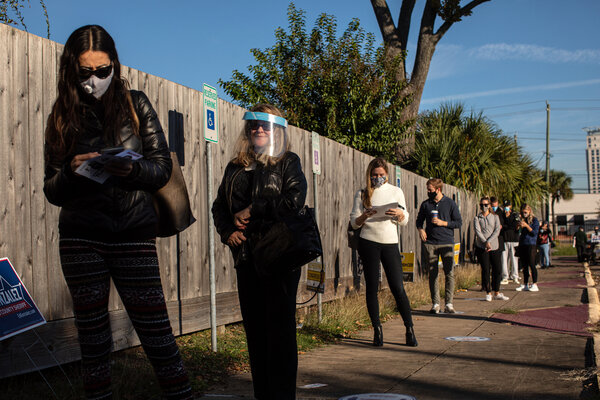 Voters in line to cast their ballots on election day in Texas, a state where Democrats hope to add house members to solidify their majority.