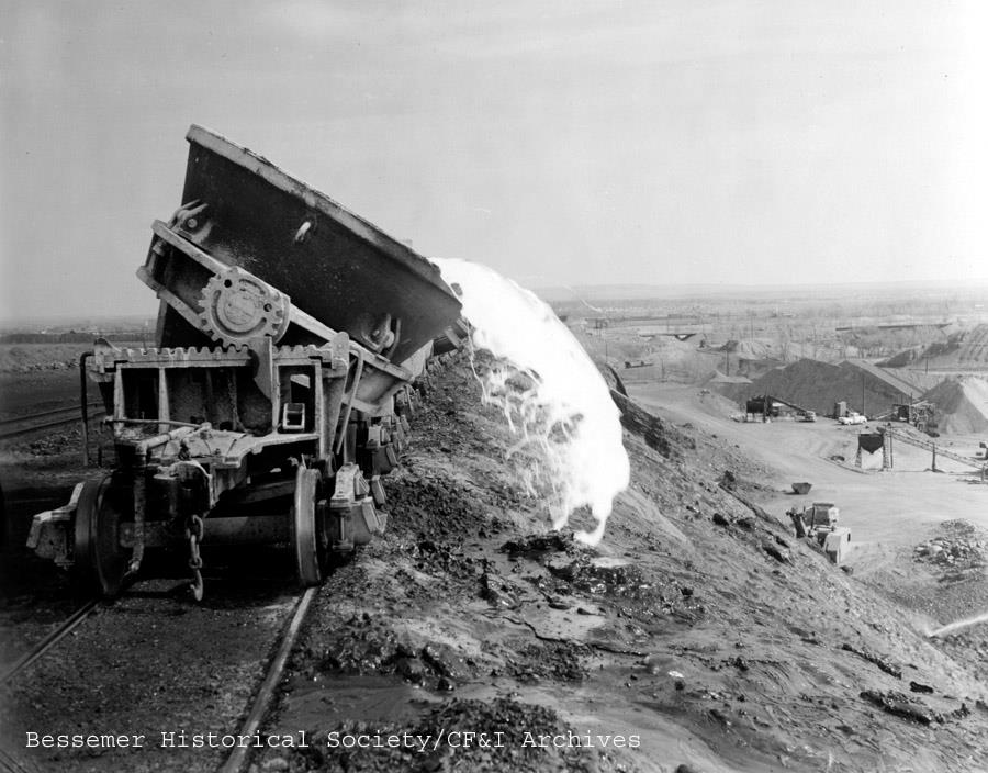 Sites such as this weren't uncommon in the golden age of Pueblo's steel industry. This image is from the 1950s where slag is being dumped east of the CF&I. This scene would be similar at the Colorado Smelter, just north of the current Eiler's neighborhood, where the smelter dumped slag into a nearby ravine. The smelter ceased operations in 1908 but the slag remained. Photo courtesy the Bessemer Historical Society / CF&I Archives.