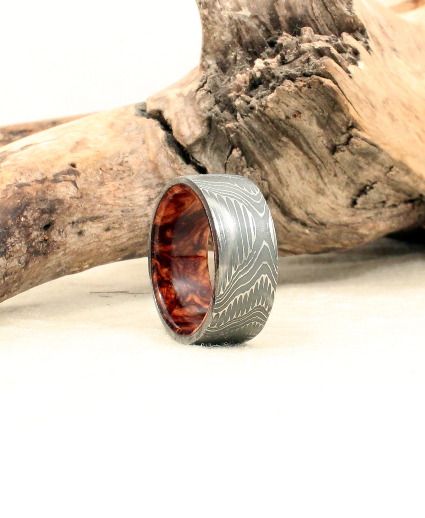 notable rings damascus steel wedding bands Hand wrought damascus steel and honduras rosewood burl wooden ring