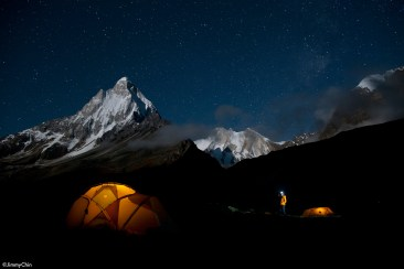 One last look before bed. Renan Ozturk checking out the stars above basecamp the night before the approach to the base of the route.