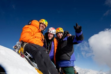 Jimmy Chin, Conrad Anker and Renan Ozturk celebrating the summit and their ascent of the Shark's Fin after 11 days of climbing.