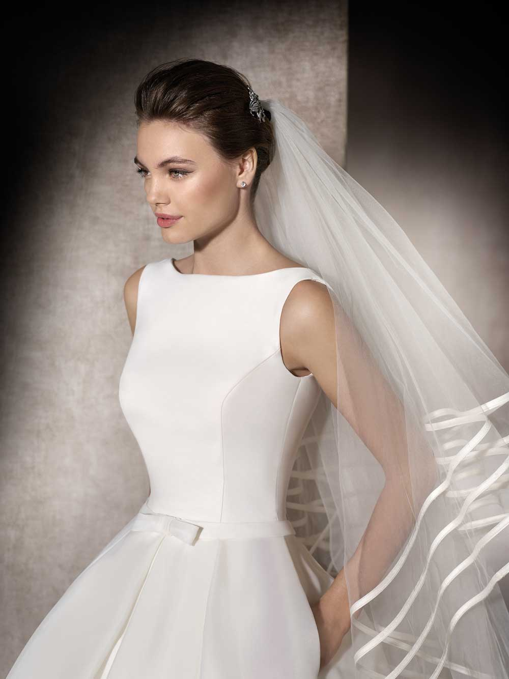 st patrick collection plain wedding dresses Merced A gorgeous silk wedding dress with a high plain neckline low scoop back thin waisted belt with a pretty flat bow and full pleated skirt