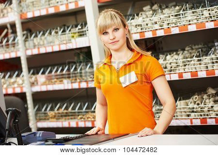 Positive female seller or shop assistant portrait in hardware
